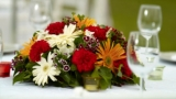 Decorate the table with fruit and flowers